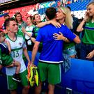History boys: Corry and Jonny Evans, being hugged by his wife, became the first brothers to represent Northern Ireland at a major finals