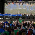 Pacemaker press 27/06/2016 Northern Ireland home coming at the fan zone in Belfast's Titanic quarter. Northern Ireland arrived home as heroes after qualifying for the last 16 of the Euro's. Thousands attended the home coming to show their appreciation for the team after they were put out by wales. Picture Mark Marlow/pacemaker press