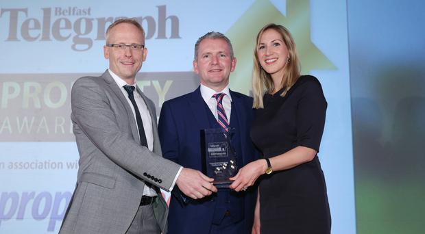 Paul McKenna (centre) MD of mac-interiors presents Aine Glackin and Claude Maguire of White Ink Architects with an award for Commercial Architectural Practice of the Year at the Belfast Telegraph Property Award