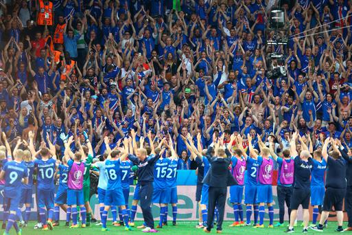 Iceland supporters celebrate their team's 2-1 win after the UEFA EURO 2016 round of 16 match between England and Iceland at Allianz Riviera Stadium on June 27, 2016 in Nice, France. (Photo by Alex Livesey/Getty Images)