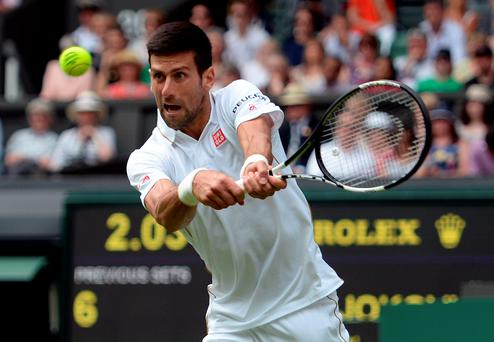 Big hit: Novak Djokovic showed his class to beat Britain's James Ward in the opening round of Wimbledon