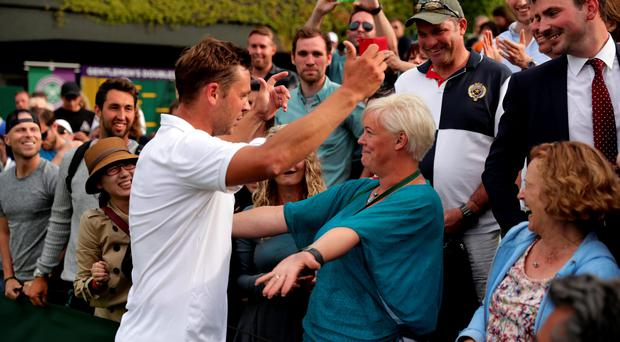 Mum's the word: Marcus Willis celebrates victory with his mother