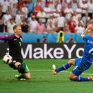 Cold as Ice: Ragnar Sigurdsson beats England goalkeeper Joe Hart to get his side back on level terms in Nice