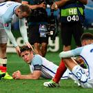 Down and out: Wayne Rooney, Gary Cahill and Dele Alli feel the pain as England crash out of Euro 2016 in humiliating fashion