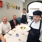Niall McKenna from James Street South (left) with Minister for the Economy Simon Hamilton and apprentices Dylan Turner and Stephanie Tinsley