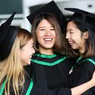 Graduating from Ulster University today with degree in Food Nutritian, Law Yan Ting, Ghan, Chu Yu and Chung, Hiu Shan from Hong Kong. Pic By Paul Moane / Aurora PA