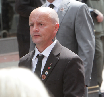 Ricky Millar pictured taking part in the Battle of the Somme centenary parade through Belfast city centre with Swastika tattoo clearly on show.
