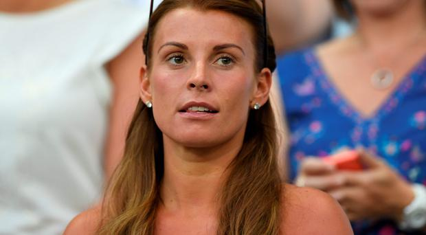 Coleen Rooney, wife of England's forward Wayne Rooney, attends the Euro 2016 round of 16 football match between England and Iceland at the Allianz Riviera stadium in Nice on June 27, 2016. Pic: Getty