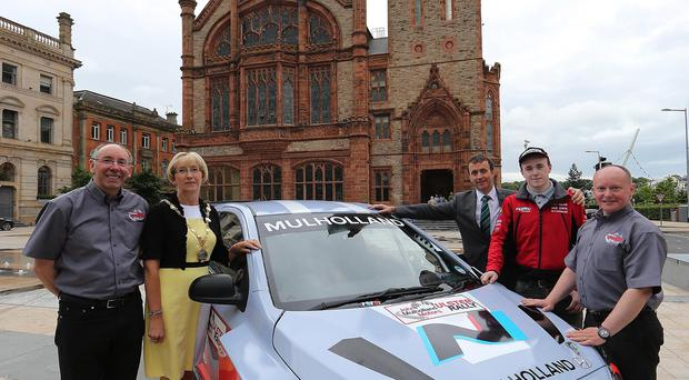 Rallying call: The Mayor of Derry and Strabane District Council, Alderman Hilary McClintock, at the launch of the Ulster Rally along with clerk of the course, Gary Milligan, sponsor John Mulholland, competitor Adam Bustard and Maiden City MC's Ian Connolly, deputy clerk of the course