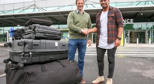 Touch down: Ulster Rugby's big new signing Charles Piutau arrives at the George Best Belfast City Airport and is welcomed by Ulster Rugby Operations Director Bryn Cunningham