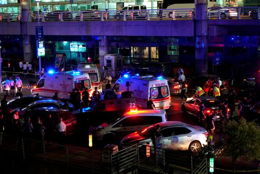 Security and ambulances block the road outside Turkey's largest airport, Istanbul Ataturk, after it was hit by a suicide bomb attack on June 28, 2016, Turkey. (Photo by Mehmet Ali Poyraz/Getty Images)