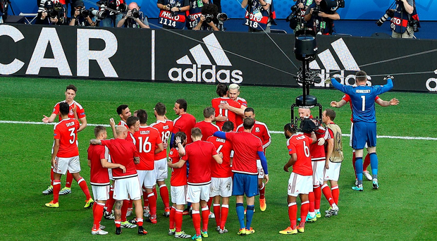 Not going home: Wales celebrate victory over Northern Ireland