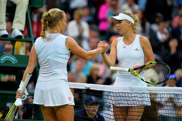 Net loss: Caroline Wozniacki (right) after yesterday's defeat against Svetlana Kuznetsova at Wimbledon