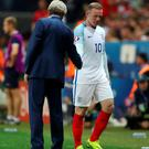 No rift: Wayne Rooney insists the entire team backed Roy Hodgson