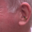 Martin McGuinness stays calm during interview as wasp climbs into his ear.