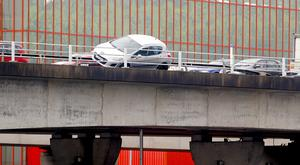 A car on the M3 Lagan Bridge sits perched on the crash barrier over the River Lagan in Belfast, Northern Ireland on June 29 2016 ( Photo by Kevin Scott )