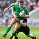 World Rugby U20 Championship, Manchester City Academy Stadium, Manchester, England 11/6/2016 New Zealand vs Ireland Adam McBurney of Ireland is tackled Mandatory Credit ©INPHO/Camerasport/Dave Howarth