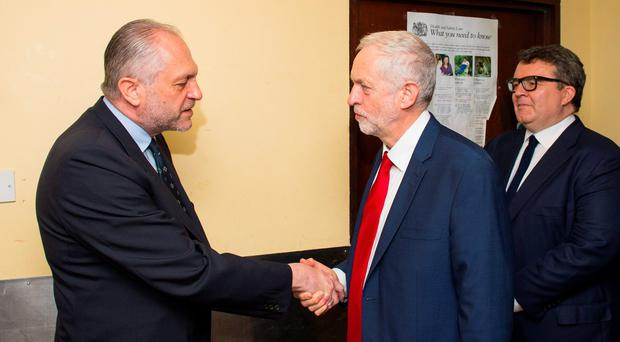 Ambassador of Poland Witold Sobkow (left) greets Labour Leader Jeremy Corbyn and his deputy Tom Watson during a visit to the Polish Social Cultural Association in Hammersmith, west London, which was vandalised with anti-immigration graffiti. PA
