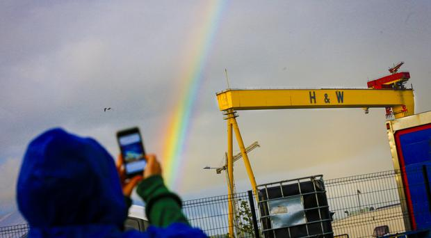 fans take pictures of a rainbow over Harland and Wolf as The Stereophonics perform on stage during Belsonic in Belfast, Northern Ireland on June 29 2016 ( Photo by Kevin Scott )