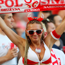 A Polish supporter cheers before the Euro 2016 quarter-final football match between Poland and Portugal at the Stade Velodrome in Marseille on June 30, 2016. / AFP PHOTO / Valery HACHEVALERY HACHE/AFP/Getty Images