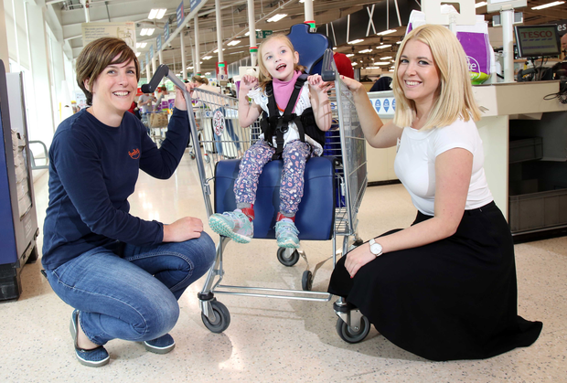 Claire Smith, Firefly's community manager, Bethany Watson (5) and Tesco's customer equipment operations manager Chloe Bartlett