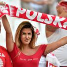 A Poland supporter holds a scarf prior to the Euro 2016 quarterfinal soccer match between Poland and Portugal, at the Velodrome stadium in Marseille, France, Thursday, June 30, 2016. (AP Photo/Martin Meissner)