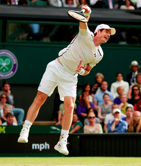 Full flow: Andy Murray smashes in a serve during his victory over Yen-Hsun Lu in the second round of Wimbledon