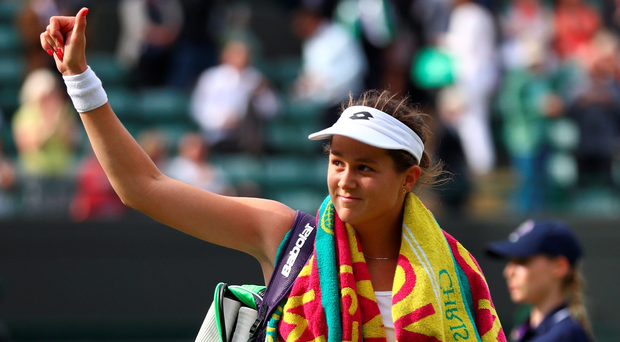 Wave goodbye: Jana Cepelova celebrates her victory over Gabrine Muguruza