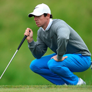 In too deep: Rory McIlroy on his way to a level par 71 in Paris after finding the lake twice