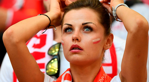 A Poland supporter looks on prior to the Euro 2016 quarter-final football match between Poland and Portugal at the Stade Velodrome in Marseille on June 30, 2016. / AFP PHOTO / BERTRAND LANGLOISBERTRAND LANGLOIS/AFP/Getty Images