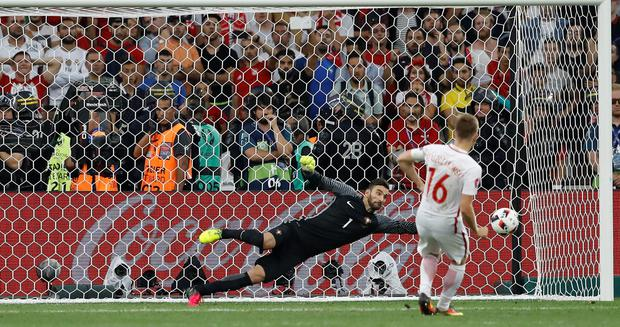 Portugal goalkeeper Rui Patricio saves a penalty by Poland's Jakub Blaszczykowski during the Euro 2016 quarterfinal soccer match between Poland and Portugal, at the Velodrome stadium in Marseille, France, Thursday, June 30, 2016. Portugal won 5-3 in a penalty shootout. (AP Photo/Frank Augstein)