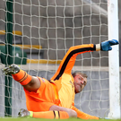 Spot of bother: Roy Carroll had an impressive debut for Linfield but was unable to keep out the Cork penalty