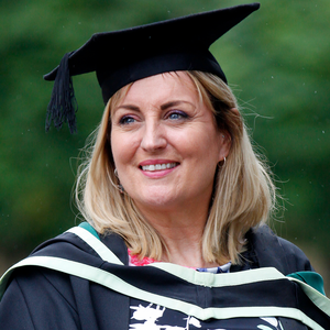 Lynda Bryans in her robes after being awarded a PGCE in education from the Ulster University