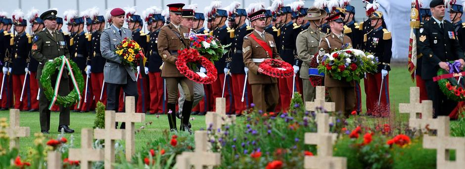Soldiers arrive to leave sprays of flowers as they take part in the memorial ceremony on July 1, 2016 at the Thiepval Memorial, in Thiepval, during which Britain and France will mark the 100 years since soldiers emerged from their trenches to begin one of the bloodiest battles of World War I (WWI) at the River Somme. / AFP PHOTO / POOL / STEPHANE DE SAKUTINSTEPHANE DE SAKUTIN/AFP/Getty Images