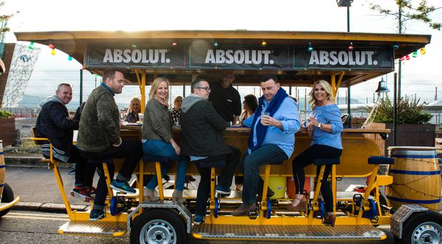 Guests enjoy the Wee Toast Tours on the way to the Absolut VIP tent at Belsonic, Belfast.