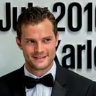 Actor Jamie Dornan poses for photographers at the opening ceremony of the 51st Karlovy Vary International Film Festival (KVIFF) on July 1, 2016 in Karlovy Vary, Czech Republic. (Photo by Matej Divizna/Getty Images)
