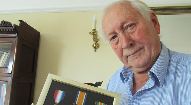 Remembered with pride: Alf McCreary with his grandfather Tommy's medals