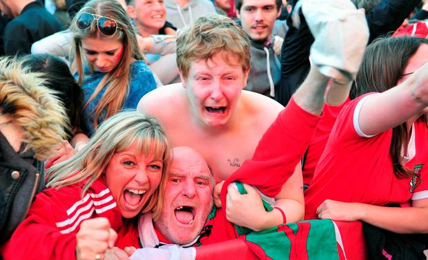 Wales fans celebrate their teams second goal during the Wales v Belgium game at Coopers Field fanzone, Cardiff. PRESS ASSOCIATION Photo. Picture date: Friday July 1 2016. See PA story SOCCER Wales. Photo credit should read: Simon Galloway/PA Wire.