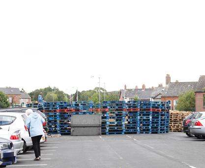 Pallets for a bonfire are stacked near the Comber Greenway in east Belfast, blocking a cycle path leading into the city