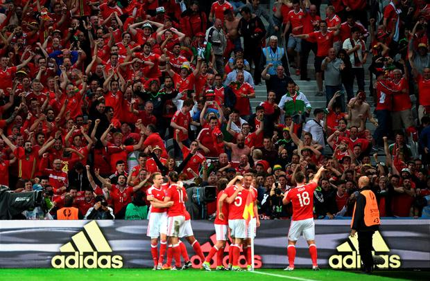 LILLE, FRANCE - JULY 01: Wales players celebrate their 3-1 win after the UEFA EURO 2016 quarter final match between Wales and Belgium at Stade Pierre-Mauroy on July 1, 2016 in Lille, France. (Photo by Michael Regan/Getty Images)