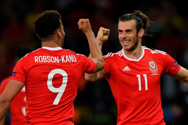 Wales' forward Hal Robson-Kanu (L) celebrates after scoring a goal with Wales' forward Gareth Bale (R) during the Euro 2016 quarter-final football match between Wales and Belgium at the Pierre-Mauroy stadium in Villeneuve-d'Ascq near Lille, on July 1, 2016. / AFP PHOTO / PAUL ELLISPAUL ELLIS/AFP/Getty Images