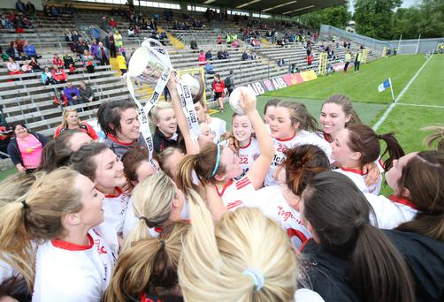 Just champion: Tyrone players celebrate their success after picking up their first trophy since 2009. Photo: Andrew Paton/INPHO