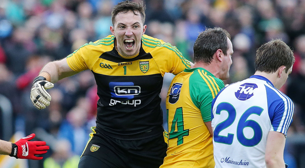 Game over: Donegal's Mark Anthony McGinley celebrates his side's victory over Monaghan in the semi-final replay