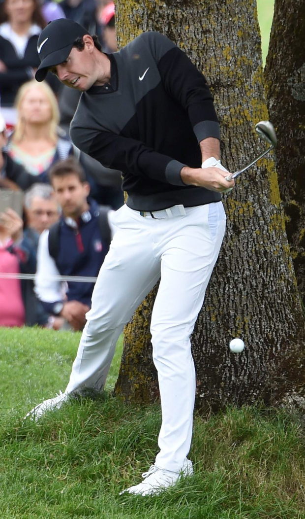 In the swing: Rory McIlroy is working on his game as the Open looms