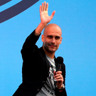 Hello Manchester: Pep Guardiola greets supporters at City's academy base