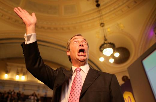 Leader of UKIP Nigel Farage takes the applause after addressing delegates during his keynote speech on September 20, 2013 in London, England. Members of the United Kingdom Independent Party have gathered at Central Hall, Westminster for the annual conference. Nigel Farage has predicted that the party will come first in next year's European elections, saying it is