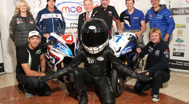 Winning line-up: top road racers Maria Costello, Ian Hutchinson, Dan Kneen, Dean Harrison, Peter Hickman and Ivan Lintin joined Mayor of Lisburn and Castlereagh City Council Brian Bloomfield, clerk of the course Noel Johnston and Big Ed from title sponsors MCE Insurance at the launch in Lisburn