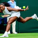 Full stretch: Serena Williams returns Svetlana Kuznetsova's serve in her straight-sets victory over the Russian