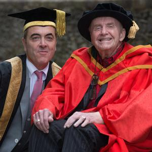 Ivan Cooper and James Nesbitt share a laugh during yesterday's ceremony at the Magee campus
