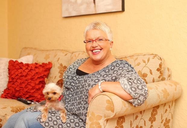 Ruth Patterson relaxing at home in east Belfast with her pet dog Paisley